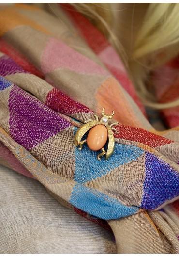 Orange beetle brooch